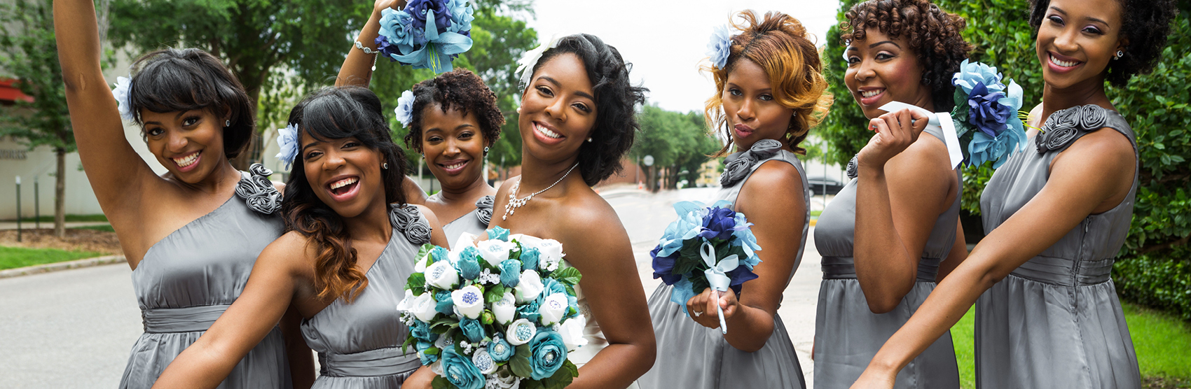 Happy African American bride with her bridesmaids