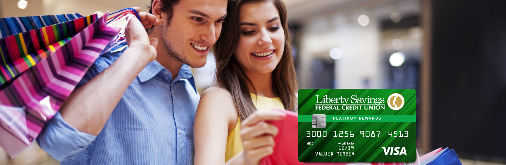 Photo of couple shopping for clothes with Visa card image