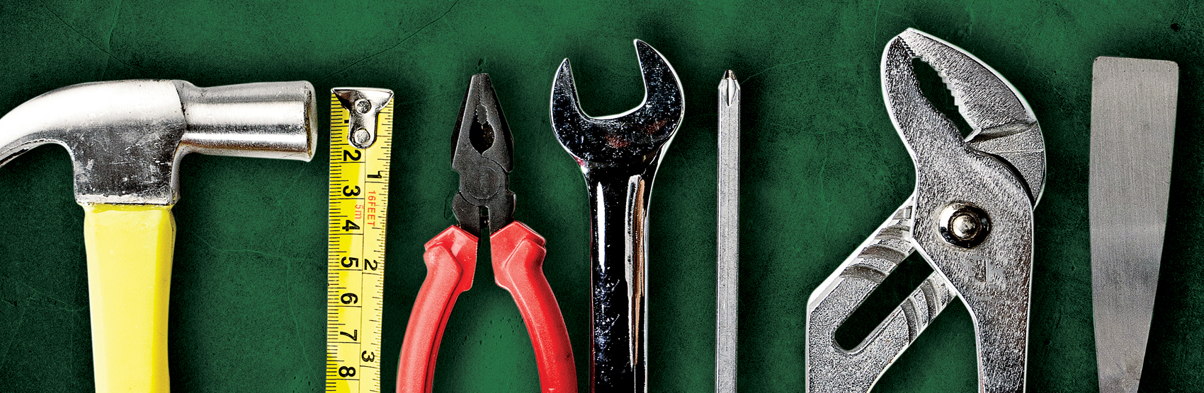 Tools on green background