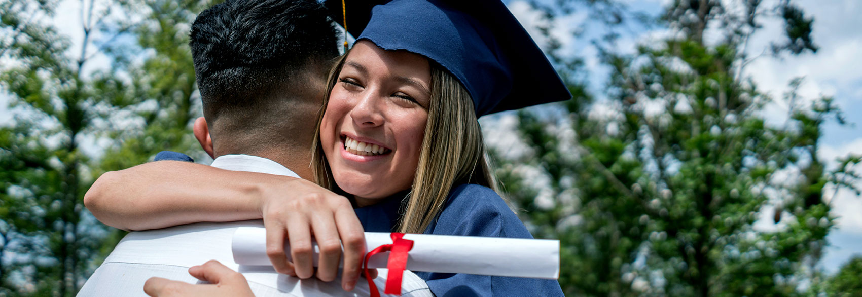 Graduation with woman hugging a man