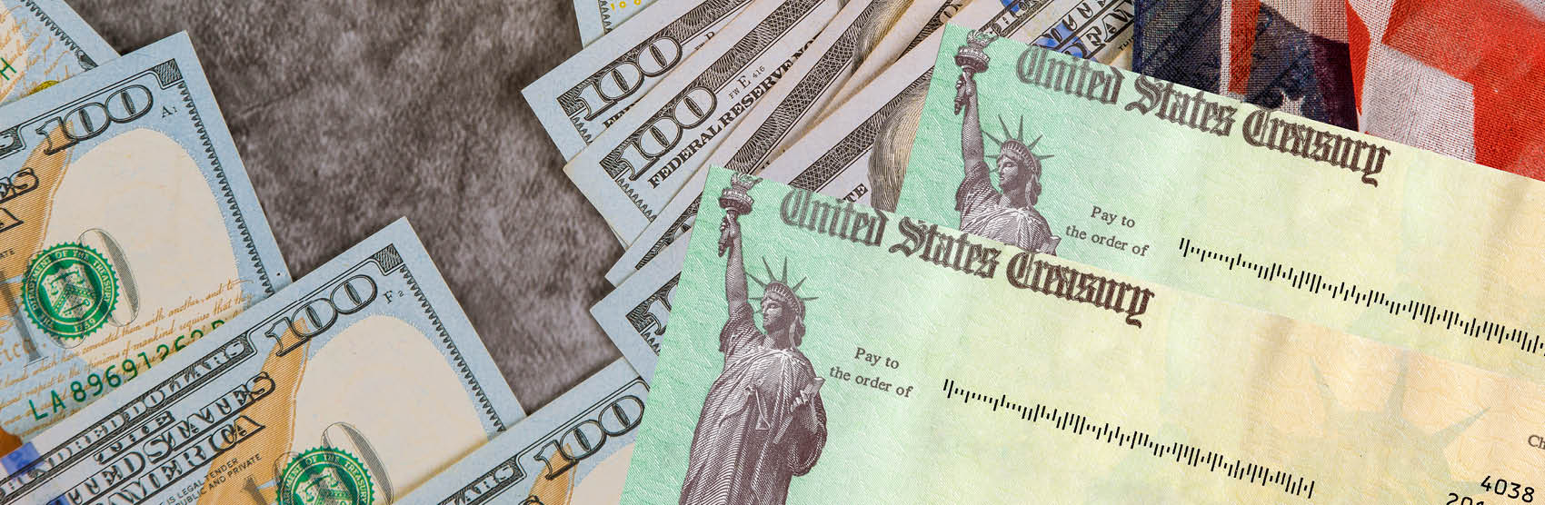 Image of American dollars and blank US treasury checks
