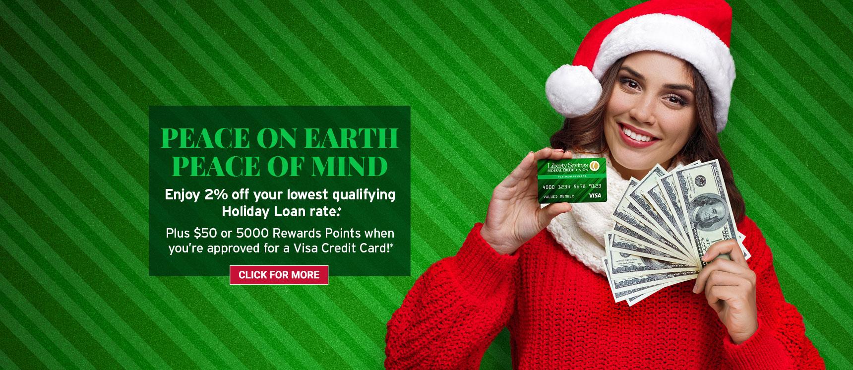 Happy woman holding holiday loan cash and a liberty savings visa credit card