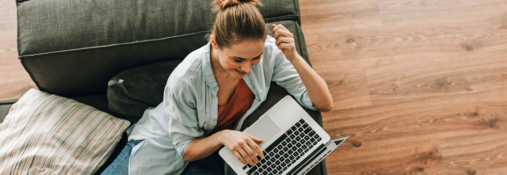 Woman using laptop to check her online account